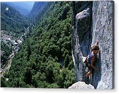 Woman Rock Climbing High Above River Acrylic Print by Heath Korvola
