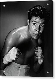 Young Adult Man In A Fighting Stance Acrylic Print by Superstock