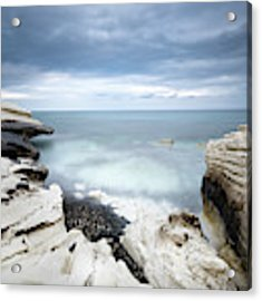 Rocky Coast With White Limestones And Cloudy Sky Acrylic Print by Michalakis Ppalis