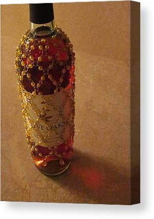 The White Wine Bottle In Its Netting Casts A Red Ethereal Glow On The Canvas Prints
