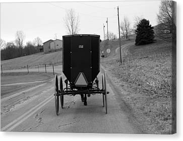 A Cold Amish Ride Canvas Print by Wendy Aycox  Newkirk