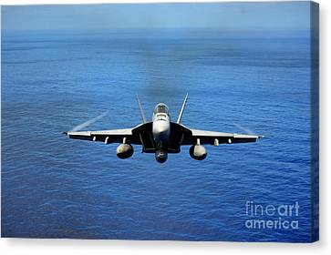 Canvas Print featuring the photograph  A Fa-18 Hornet Demonstrates Air Power. by Paul Fearn