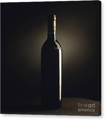 Bottle Of Bordeaux Wine Canvas Print by Bernard Jaubert