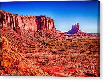 Mountain View Canvas Print -  Golden Hour Sunrise In Monument Valley by Bob and Nadine Johnston