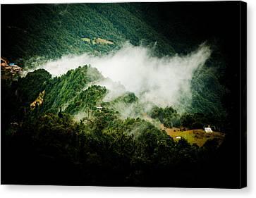 Himalayas Mountain With Mist Panaramic Canvas Print by Raimond Klavins