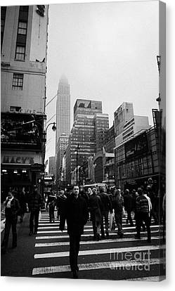 Pedestrians Crossing Crosswalk Outside Macys 7th Avenue And 34th Street Entrance New York Winter Canvas Print by Joe Fox