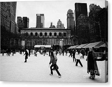Skating On The Ice At Bryant Park Ice Skating Rink New York City  Canvas Print by Joe Fox