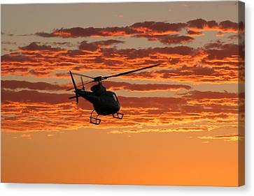Sunset Clouds Canvas Print by Paul Job