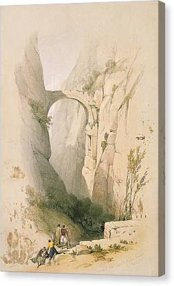 Triumphal Arch Crossing The Ravine Leading To Petra Canvas Print by David Roberts