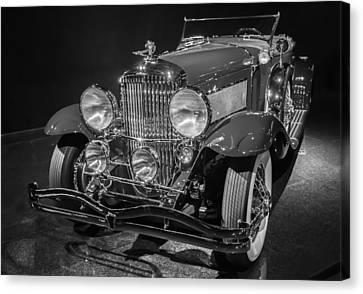 1929 Duesenberg Model J Canvas Print by Roger Mullenhour