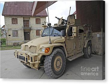 A Husky Tsv Armored Vehicle Canvas Print by Andrew Chittock