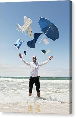 A Man Stands In The Ocean With Items Canvas Print by Ben Welsh