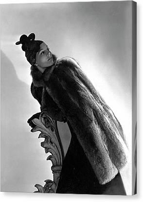 A Model Wearing A Fur Cape Canvas Print