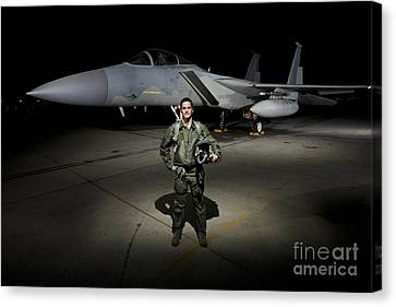 A U.s. Air Force Pilot Stands In Front Canvas Print by Terry Moore