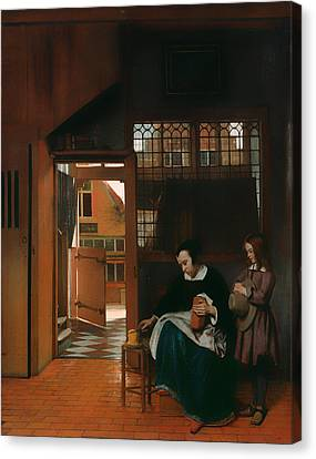 A Woman Preparing Bread And Butter For A Boy Canvas Print