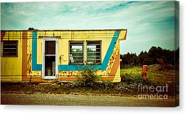 Abandoned Yellow Trailer Canvas Print by Amy Cicconi