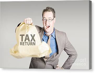 Accountant Holding Large Tax Return Refund Canvas Print by Jorgo Photography - Wall Art Gallery
