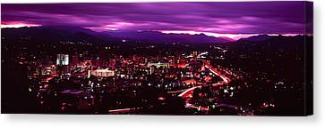 Aerial View Of A City Lit Up At Night Canvas Print
