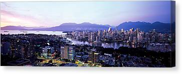 Aerial View Of Cityscape At Sunset Canvas Print by Panoramic Images