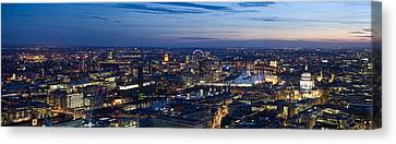 Aerial View Of The City At Dusk Canvas Print by Panoramic Images