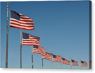 American Flag Waving In The Wind Canvas Print by Brandon Bourdages