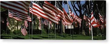 American Flags In Front Of A Home Canvas Print by Panoramic Images