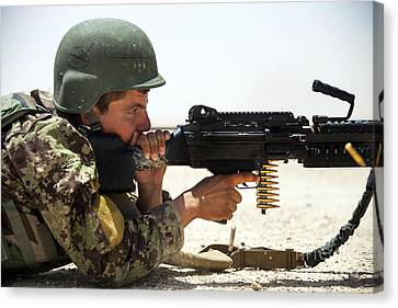 An Afghan National Army Soldier Fires Canvas Print by Stocktrek Images