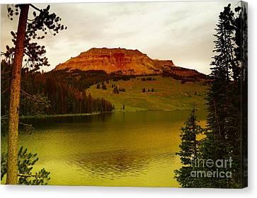 An Alpine Lake Canvas Print by Jeff Swan