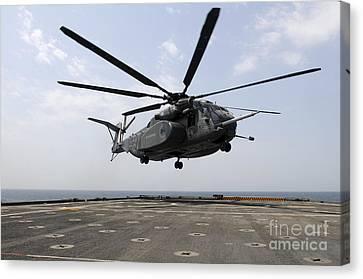 An Mh-53e Sea Dragon Prepares To Land Canvas Print by Stocktrek Images