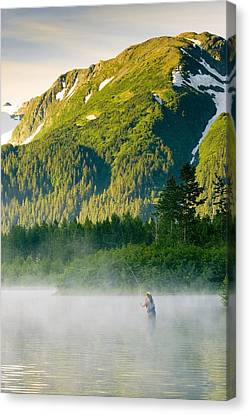 Angler Flyfishing For Rainbow Trout In Canvas Print by Michael DeYoung