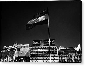 argentine flag flying in plaza republica on avenida 9 de julio Buenos Aires Argentina Canvas Print by Joe Fox