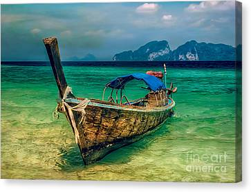 Asian Longboat Canvas Print by Adrian Evans