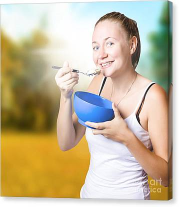 Attractive Young Blond Woman Eating Oatmeal Canvas Print by Jorgo Photography - Wall Art Gallery