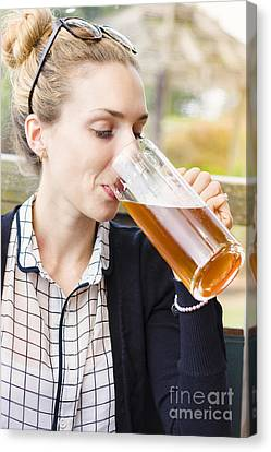 Attractive Young Woman Sipping From Beer Mug Canvas Print by Jorgo Photography - Wall Art Gallery