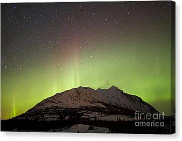 Aurora Borealis And Milky Way Canvas Print by Joseph Bradley