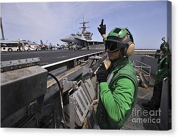 Aviation Boatswain's Mate Signals Canvas Print by Stocktrek Images