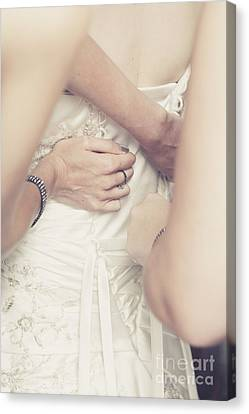 Back Of Wedding Dress With Helping Hands Of Bridesmaids Canvas Print