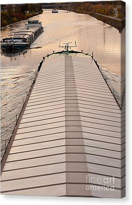 Barges Plying Waterway Channel In Industrial Area Canvas Print by Stephan Pietzko