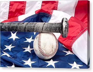 Baseball On American Flag Canvas Print by Joe Belanger