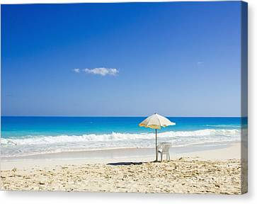 Canvas Print featuring the photograph Beach Chair And Umbrella On Idyllic Tropical Sand by Mohamed Elkhamisy