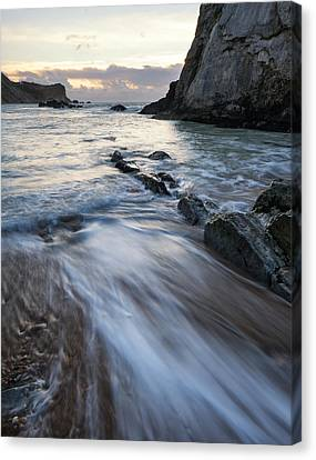 Beach Sunrise Landscape With Long Exposure Waves Movement Canvas Print by Matthew Gibson