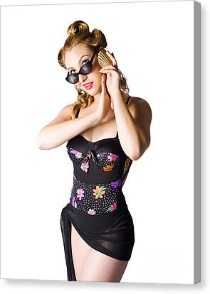 Beautiful 1950s Pinup Woman Listening To Sea Shell Canvas Print by Jorgo Photography - Wall Art Gallery