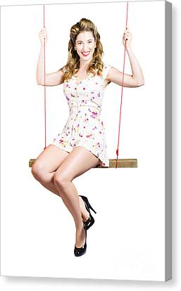 Beautiful Fifties Pin Up Girl Smiling On Swing Canvas Print