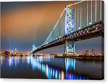 Canvas Print featuring the photograph Ben Franklin Bridge And Philadelphia Skyline By Night by Mihai Andritoiu