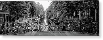 Bicycles On Bridge Over Canal Canvas Print by Panoramic Images