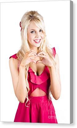 Blonde Woman Making Heart Shape Canvas Print by Jorgo Photography - Wall Art Gallery