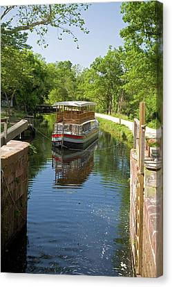 Boat Approaching An Open Canal Lock Canvas Print by Jim West
