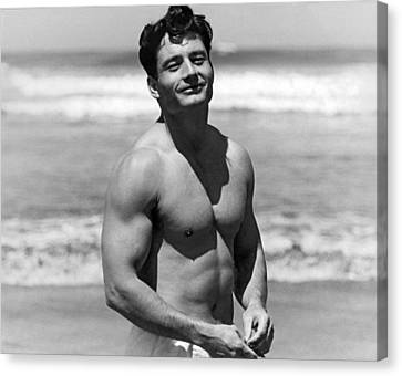 Body Builder At The Beach. Canvas Print by Underwood Archives