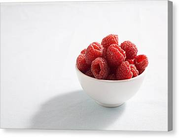 Bowl Of Raspberries Canvas Print by Greg Huszar Photography