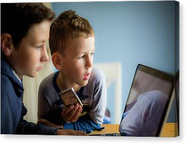 Boys Using Smartphone And Laptop Canvas Print